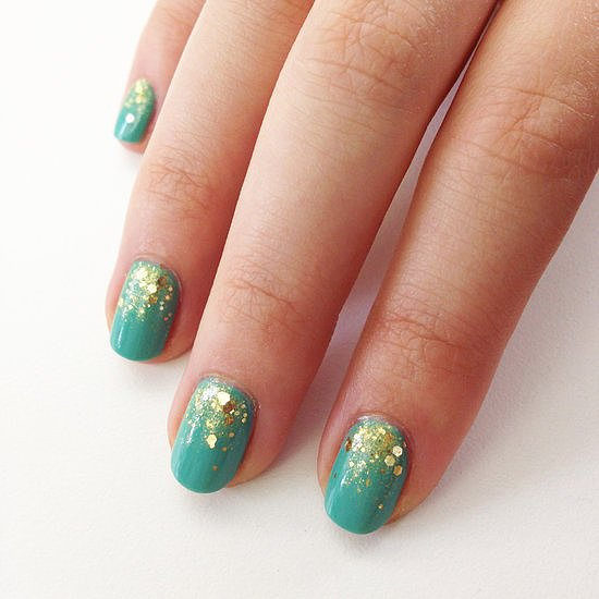 Our readers can't get enough of sparkling nail designs. Just take this teal and gold combination, which was our top-pinned post this week.