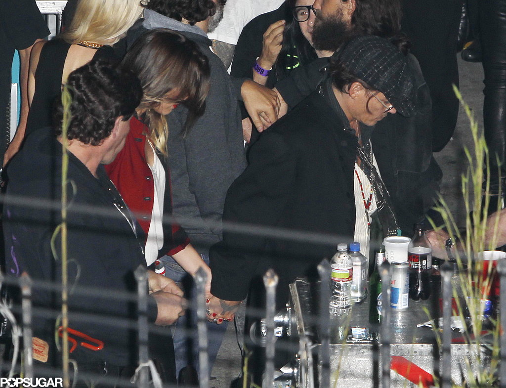 Johnny Depp and Amber Heard Show PDA at Secret Stones Show