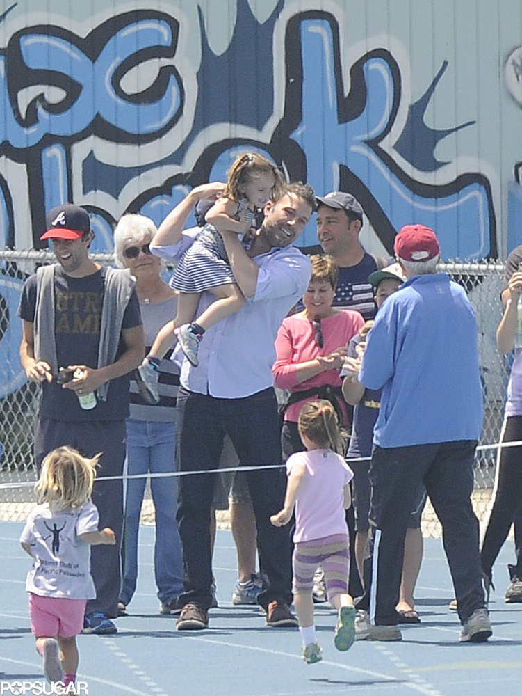 Ben Affleck congratulated daughter Seraphina at the finish line of her track meet.