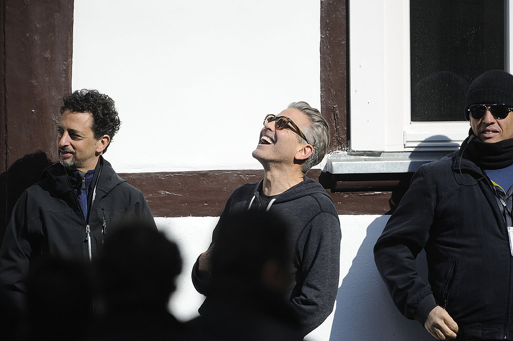 George Clooney laughed with his friend and producer Grant Heslov.