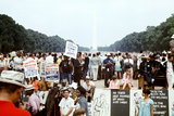 Crowds of people carried signs asking for economic aid during the Poor People March in Washington DC.