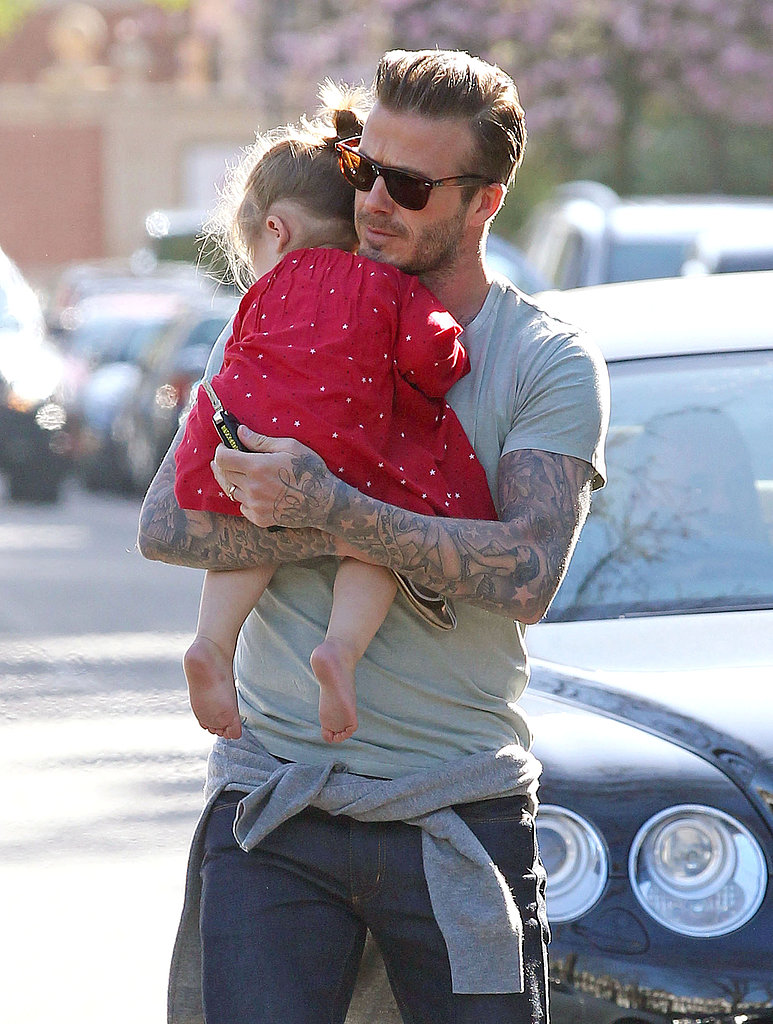 David Beckham carried a sleepy Harper Beckham through London on Monday.