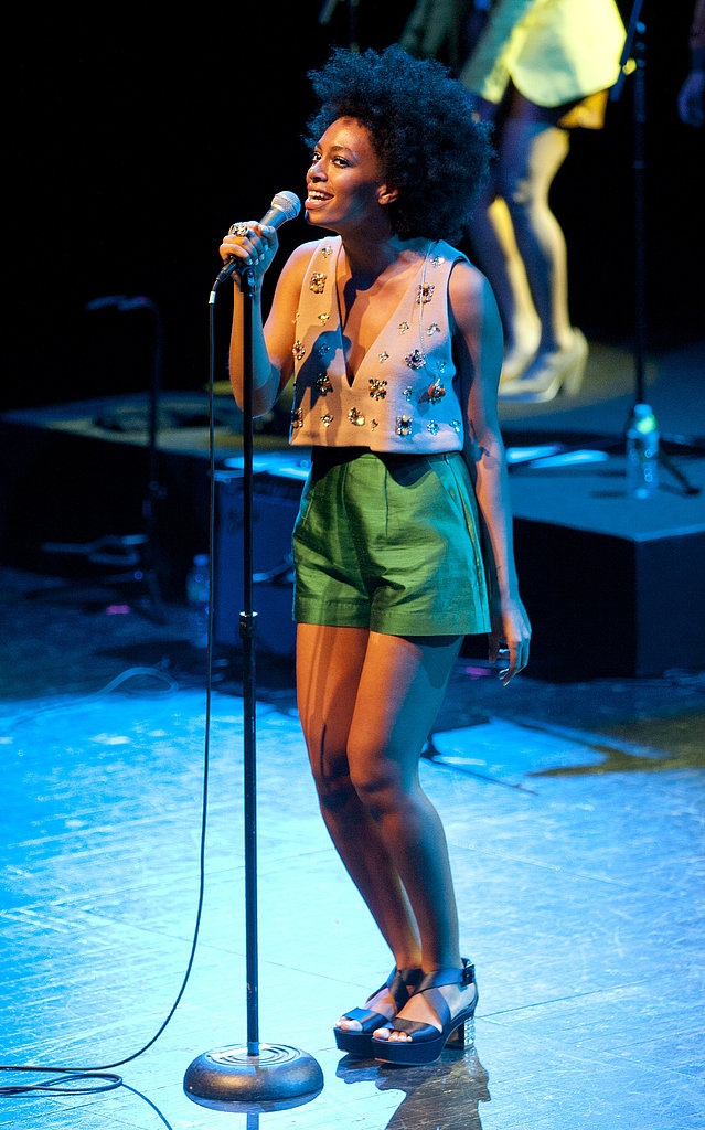 Solange Knowles performed in Brooklyn in a jeweled crop top, bright green satin shorts, and strappy platform sandals.