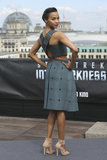 From the back, the sex appeal on Zoe Saldana's Berlin look skyrocketed. The buckle-accented crisscross straps supplied a tougher, skin-revealing vibe to the gray Calvin Klein crop top and skirt combo.