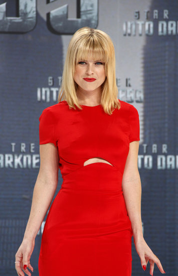 Alice Eve matched her bold red Emilio Pucci gown with an even bolder red lip and blunt bangs.