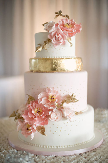 This beauty is practically blooming with pink petals and flecks of gold detail that are both timeless and tasteful.  Photo by Melissa Gidney Photography via Style Me Pretty
