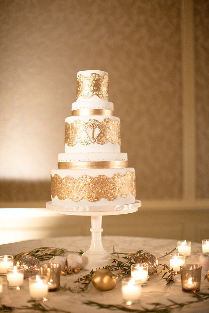 A wedding cake like this romantic, gilded version is sure to make the entire room sparkle — and who doesn't want that on their wedding day?  Photo by Jana Williams Photography via 100 Layer Cake