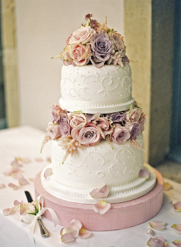 Maybe it's the purple and pink roses or elaborate design, but there's something so whimsical and lovely about this cake.  Photo by Polly Alexandre Photography via Style Me Pretty