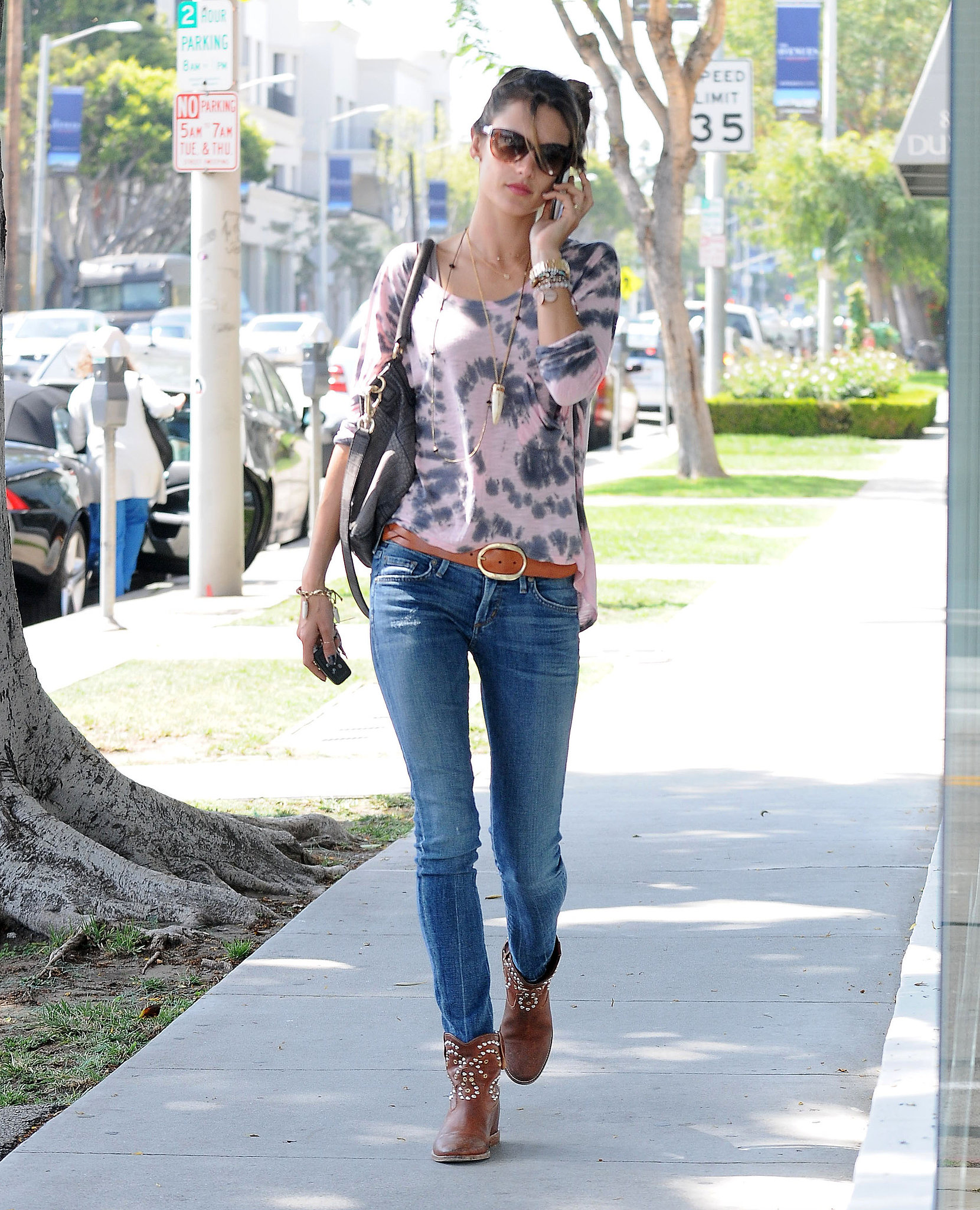 Alessandra Ambrosio worked a tie-dye top with skinny Citizens of Humanity jeans, studded cowboy boo