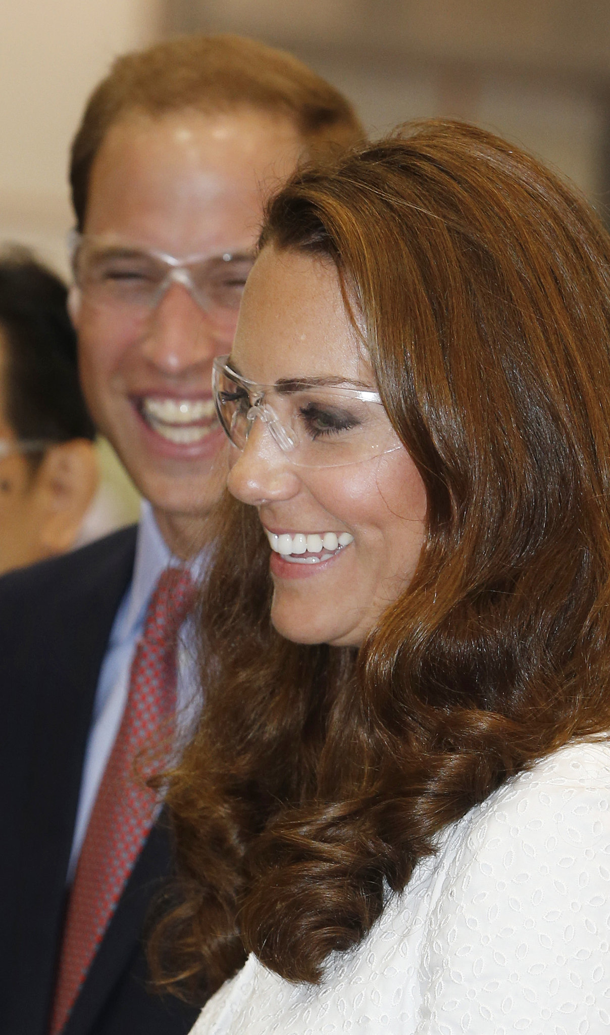 Kate and Will laughed wearing goggles at a Rolls-Royce factory in 2012.