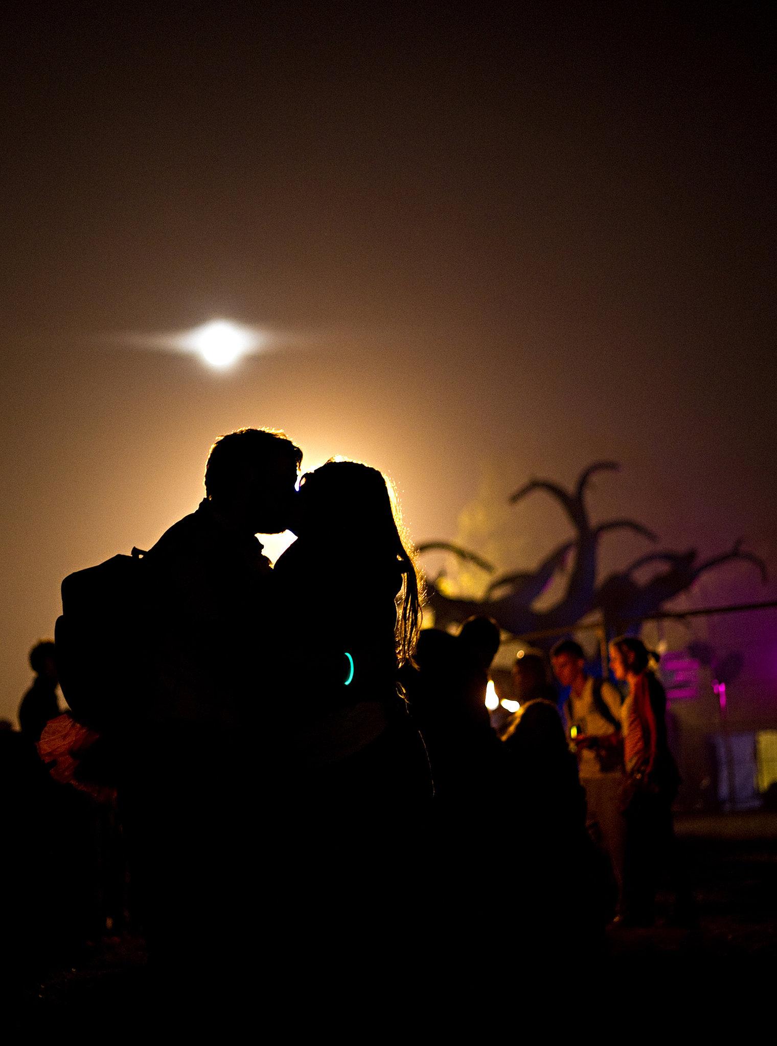A pair kissed at Glastonbury festival.