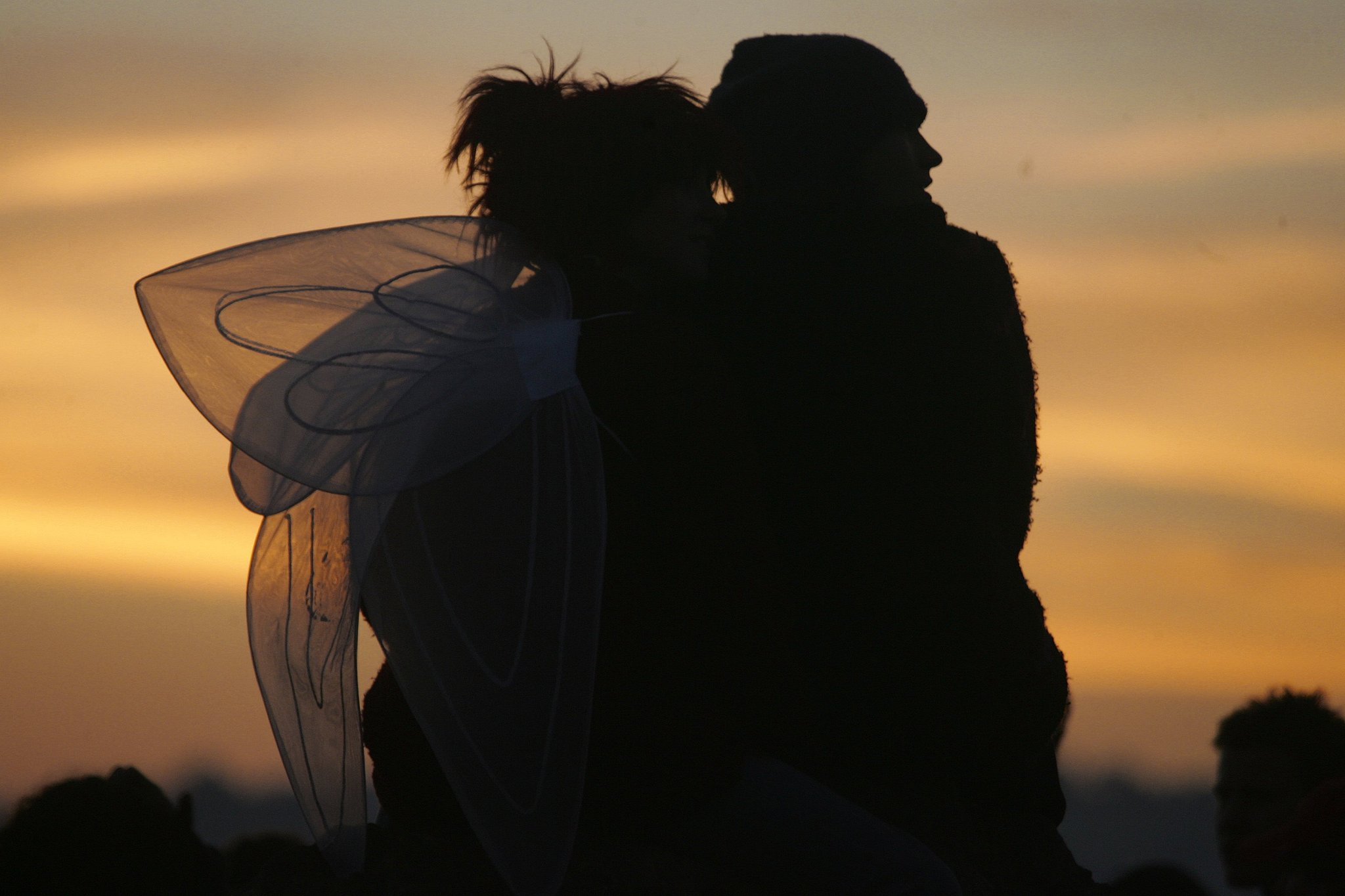 This couple got close to watch the sunrise at the Glastonbury Festival in England.