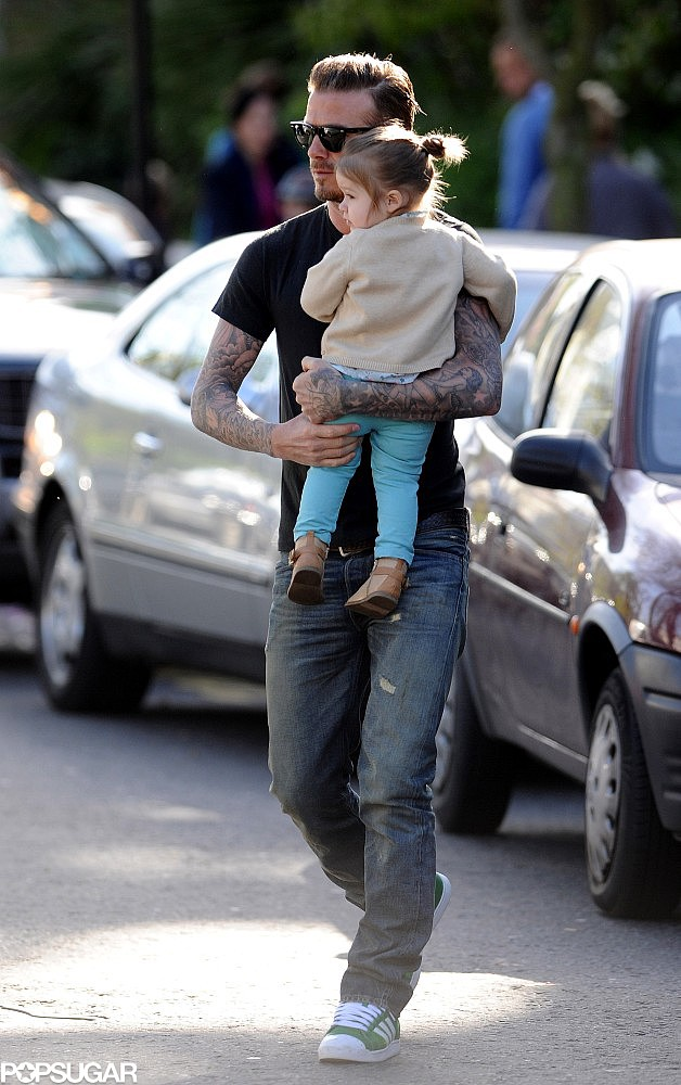 David Beckham walked with Harper in London.