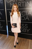Isla Fisher opted for a head-to-toe ladylike Prada look in a blush pink silk crepe dress, black platform pumps, and a black fringed leather clutch at the  Prada and The Great Gatsby festivities.