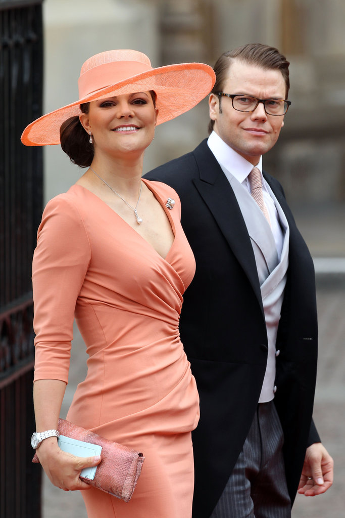 Crown Princess Victoria of Sweden matched her coral orange sun hat to her ruched gown at the royal wedding in April 2011.
