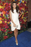 Eva Longoria picked a sculptural white dress at a Ferragamo party in NYC for a totally fashion-forward feel. A pair of white studded pumps added just the right amount of edge.