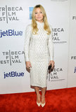 At the 2013 Tribeca Film Festival in NYC, Kate Hudson covered up (but still managed to look smashing) in a white Michael Kors sweater dress and matching Casadei pumps.