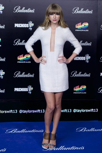 At the 2013 Principales Awards in Madrid, Spain, Taylor Swift was sultry in her white beaded Kaufmanfranco dress and Christian Louboutin platform sandals.