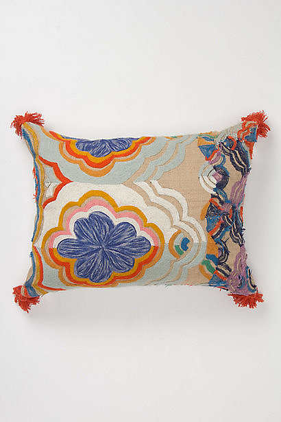 This jute and floral pillow ($108) is perfect for an eclectic yet homey space.