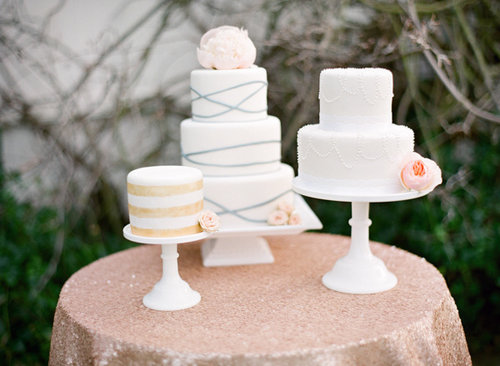 Each of these three cakes features minimalist detail and is stunning in its own right. The stripes, the crisscross lines, the beads — it's hard to pick a favorite.  Photo by Lavender & Twine via Style Me Pretty