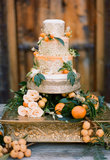 This is one occasion where there's no such thing as too much pomp and circumstance — the lace! The gold! The oranges! It's all fitting of a royal wedding, if you ask us.  Photo by Stephanie Williams of This Modern Romance  via 100 Layer Cake