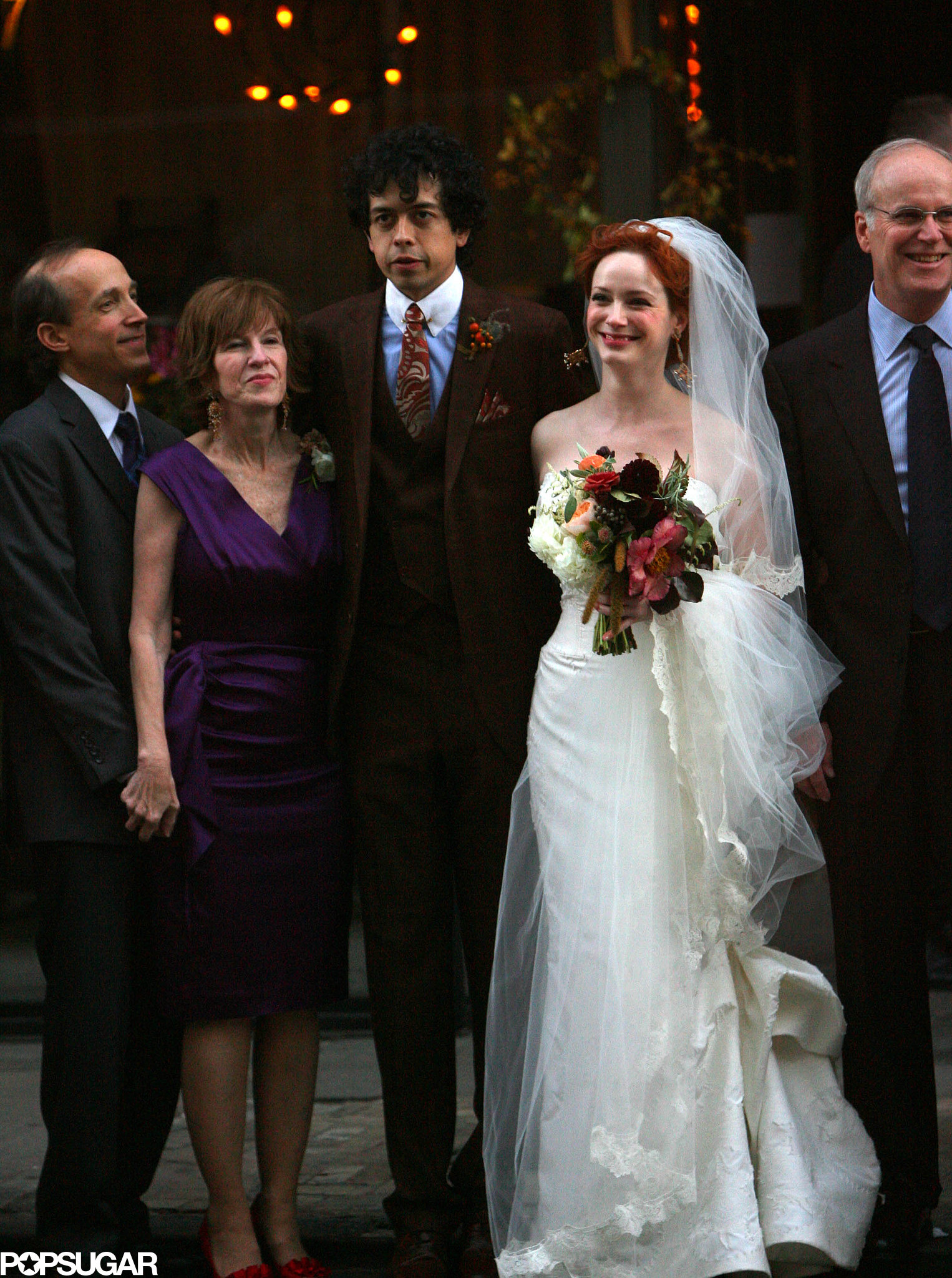 Christina Hendricks and Geoffrey Arend posed with family after their October 2009 nuptials in NYC.
