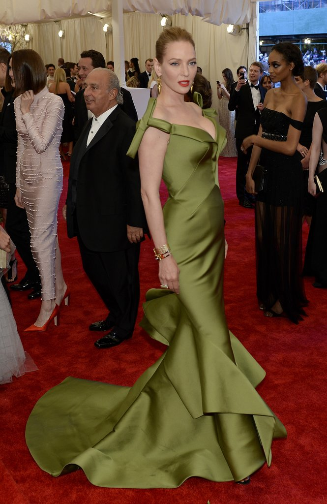 Uma Thurman passe on punk: Her green mermaid-style Zac Posen gown, with dramatic bow sleeves and a tiered skirt, was more old Hollywood than East Village.