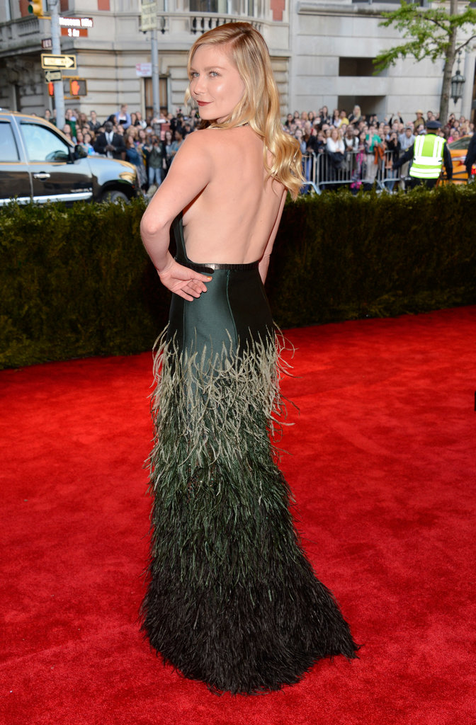 Kirsten Dunst's Louis Vuitton left her back exposed.
