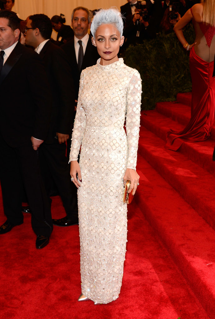 Nicole Richie may have created a shock wave with her newly silver hair, but she went conservative in an off-white beaded Topshop gown with a high neck and long sleeves. She accessorized with Vero Cuoio shoes, a House of Harlow 1960 clutch, Dana Rebecca earrings, and a Maria Francesca Pepe ring.