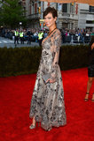 Karlie Kloss opted for a long-sleeved metallic embroidered Louis Vuitton gown and matching platform sandals.