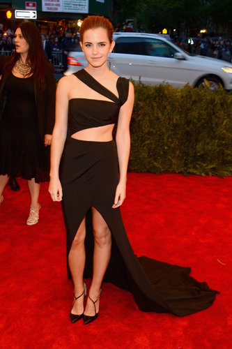 Emma Watson's black cutout Prabal Gurung gown revealed lots of sexy skin — more than we're used to seeing on her. She kept her accessories simple with Brian Atwood T-straps and Fred Leighton studs.