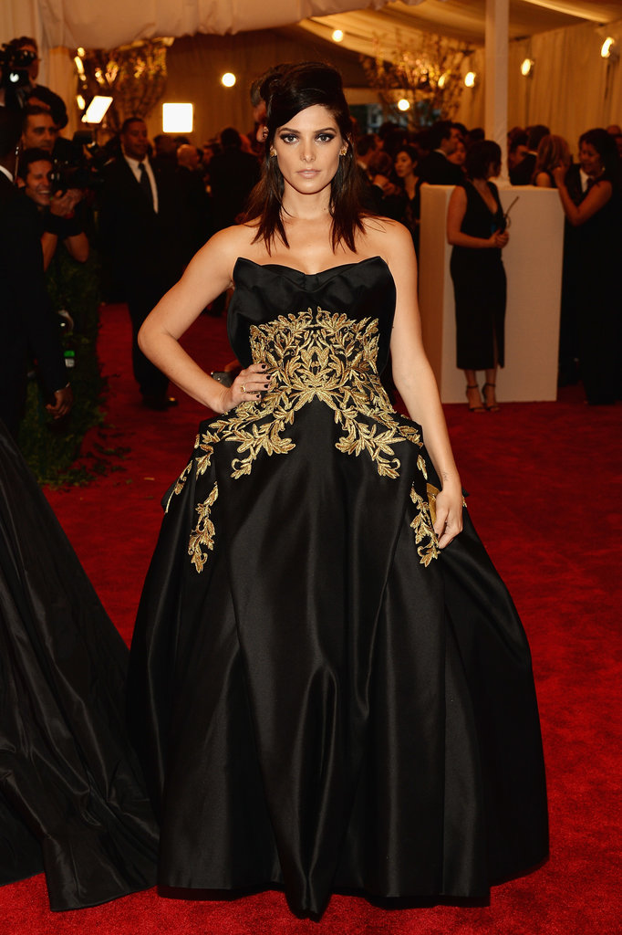Ashley Greene chose a black-and-gold strapless Marchesa ball gown with Christian Louboutin shoes for the Met Gala festivities.