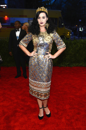 Katy Perry channeled her inner Joan of Arc in a metallic beaded Dolce & Gabbana dress, complete with a crown and cross earrings.