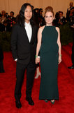 Add another milestone to Alexander Wang's Balenciaga C.V.! The designer showed up (and held hands) with Julianne Moore in a deep-emerald, petal-skirted column dress.