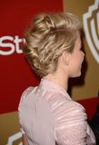 The back of her hair was twisted and pinned back, giving the sides a flattened look.