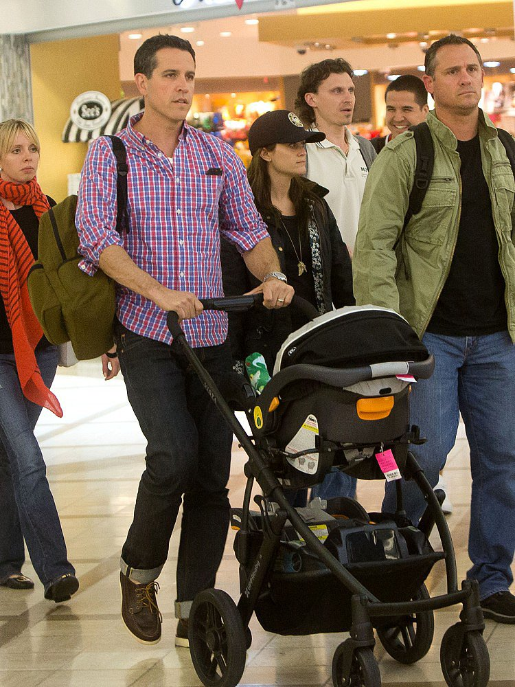 Reese Witherspoon and her husband, Jim Toth, took a flight out of Atlanta and landed in LA with their son, Tennessee.