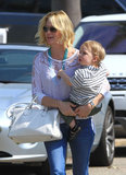 January Jones toted her son, Xander, through LA on Saturday.