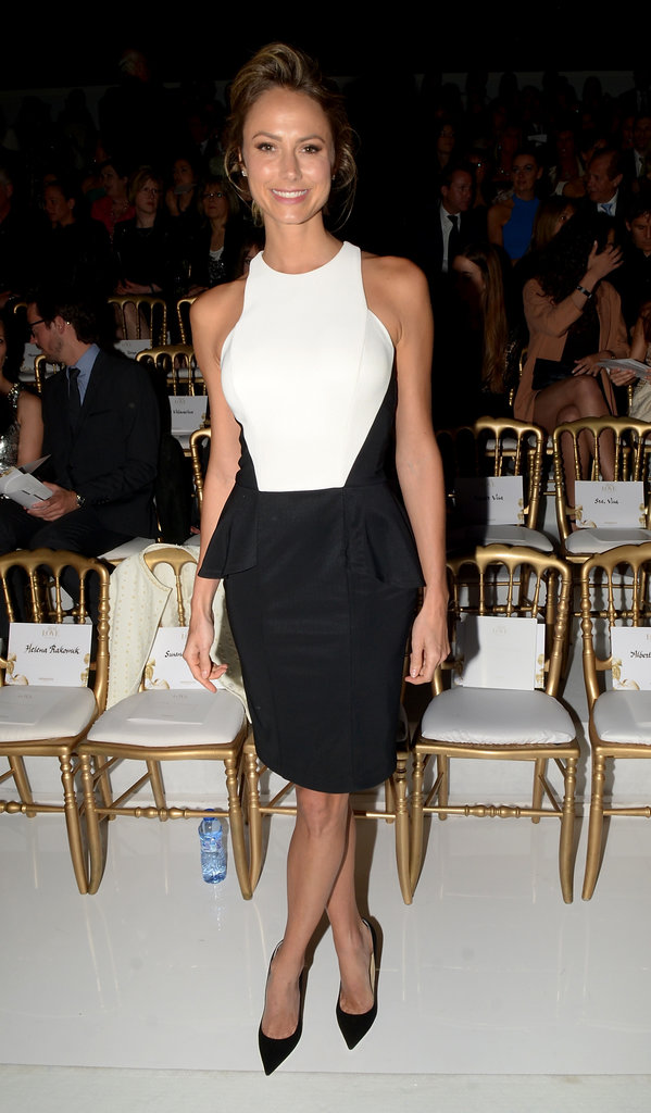 Stacy Keibler sat front row at Barcelona Bridal Week wearing a black and white dress with a darling peplum skirt.