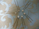 You're the star of the wedding, so why not add these charming little star hair pins ($42) into your look?