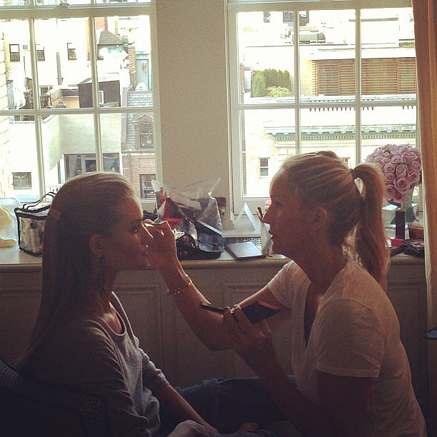 Rosie Huntington-Whiteley concentrated while getting her makeup done.  Source: Instagram user rosiehw