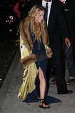 Mary-Kate Olsen dropped by the afterparty in sandals.