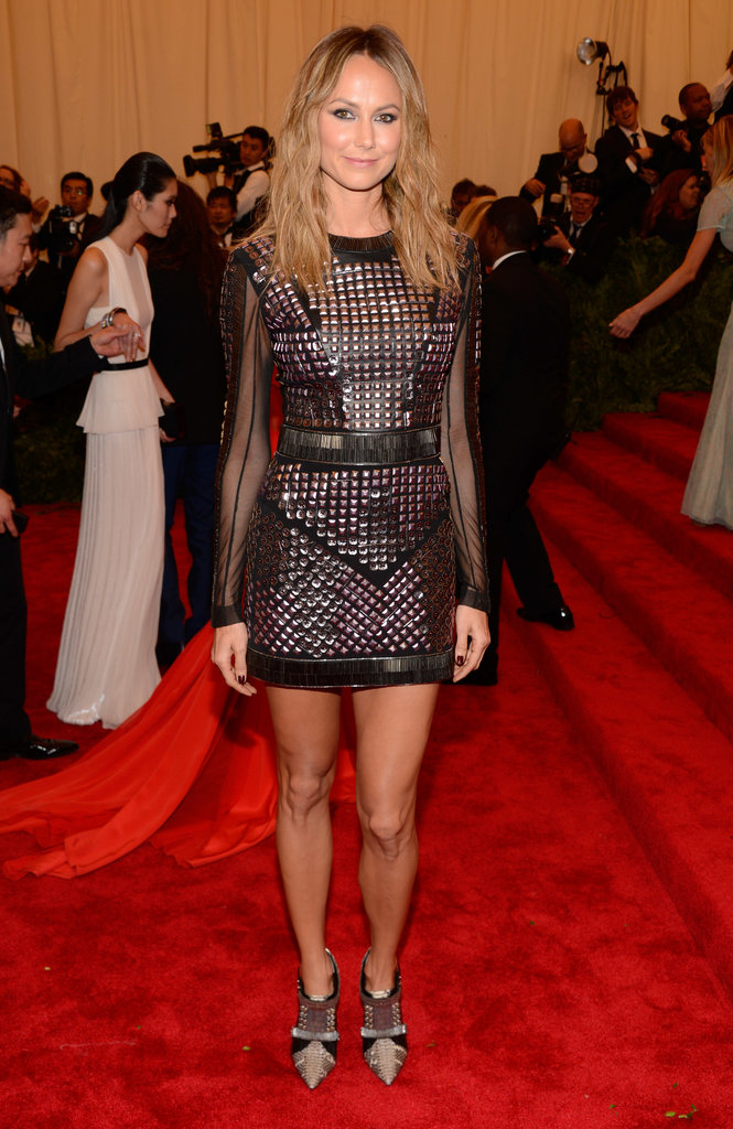 Stacy Keibler flaunted her pins in a tough-girl studded Rachel Roy minidress with sheer sleeves.