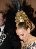 Sarah Jessica Parker wore an extravagant Philip Treacy headpiece.