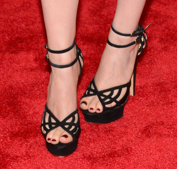 Kate Mara wore black ankle-strap cutout heels.