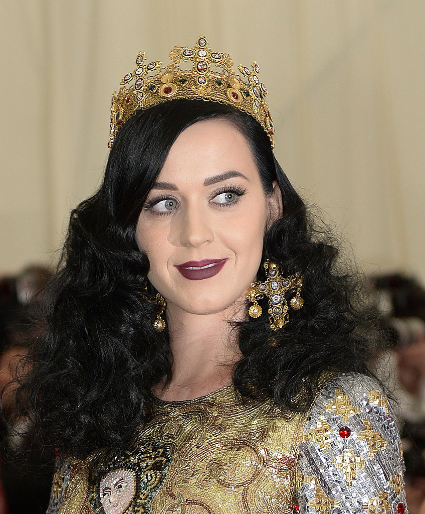 Katy Perry wore a bejeweled crown and ornate earrings.