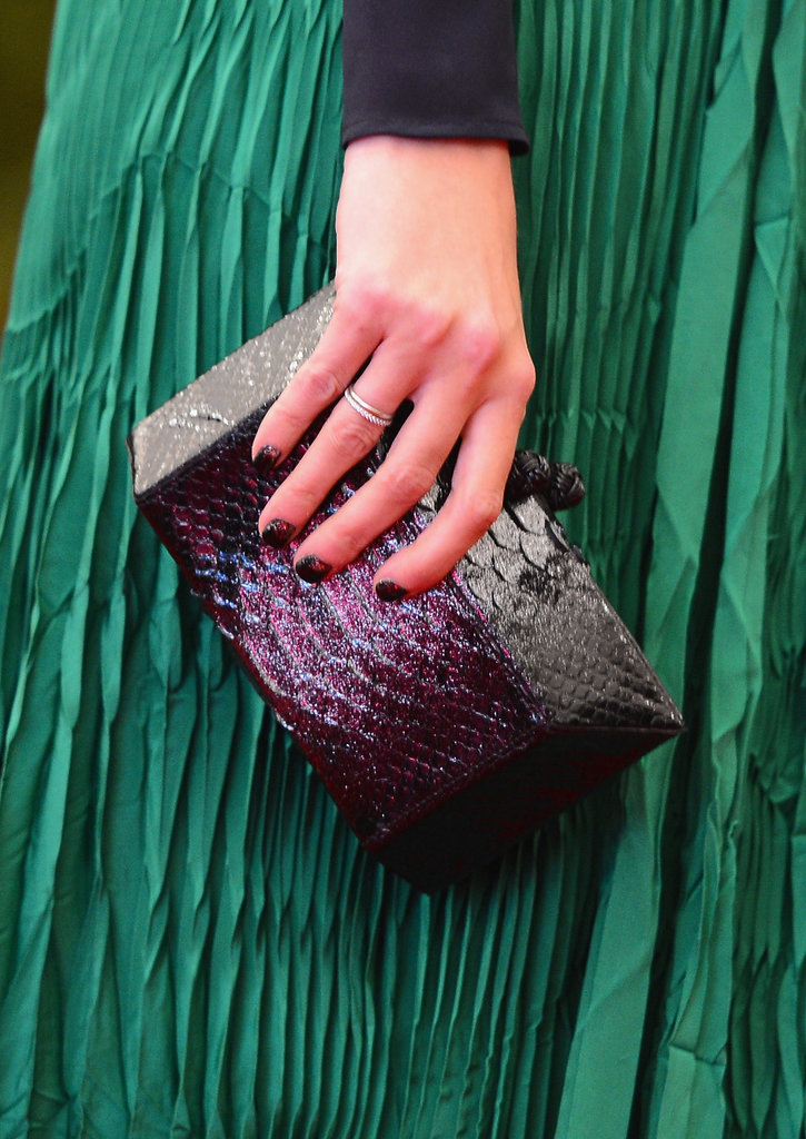 Ivanka Trump carried a colorful reptile-skin box clutch.