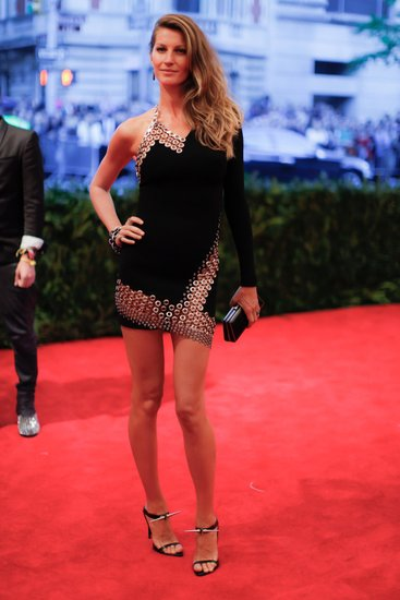 Anthony Vaccarello Bonded Crepe and Macrame One Sleeve Halter Dress ($5,290), worn by Gisele Bündchen Source: Julian Mackler/BFAnyc.com