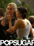 Taylor Swift chatted with Zooey Deschanel while leaving the Met Gala.