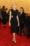 Carey Mulligan decided on a black Balenciaga by Alexander Wang cutout dress that was accented with a giant safety pin.