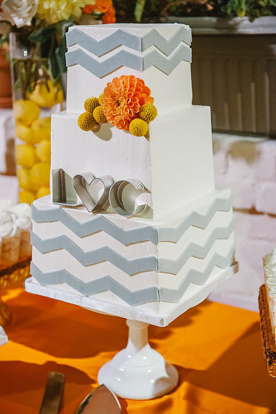 Cookie cutter initials, chevron fondant, and square tiers make this cake anything but staid.  Photo by  Luminaire Images  via Style Me Pretty